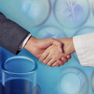 Handshake shows business and pharma working together